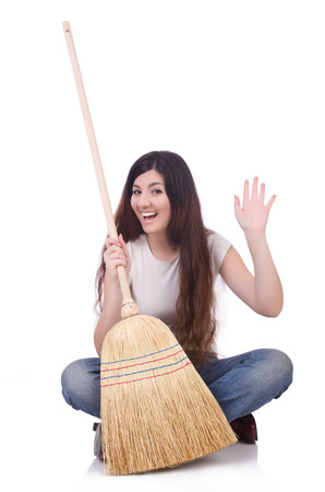 Young woman with broom on white Stock Photo - 22476031