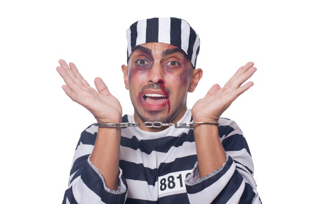 Badly bruised prisoner with handcuffs Stock Photo - 22454698