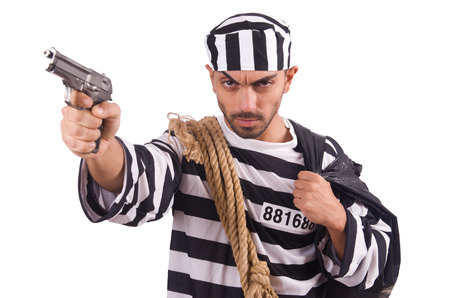 Prisoner with gun isolated on white Stock Photo - 22476058