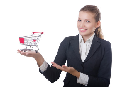 Businesswoman with shopping cart on white Stock Photo - 22476063