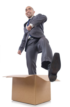 Businessman with box isolated on the white Stock Photo - 22476081