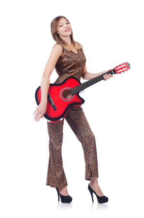Woman in leopard clothing on white with guitar photo