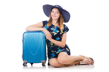 Woman with suitcases isolated on white photo