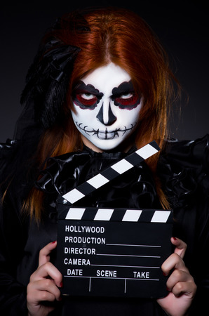 Monster with movie clapper board photo