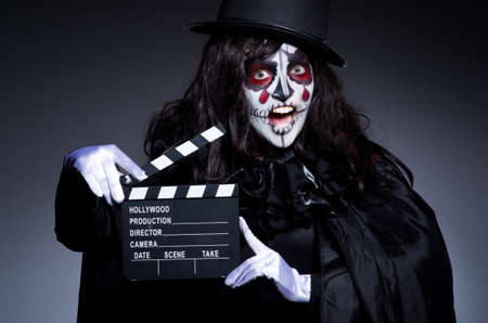 monster movie: Monster with movie clapper board