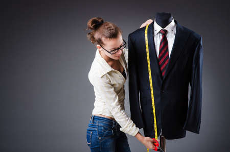 tailor suit: Woman tailor working on clothing Stock Photo