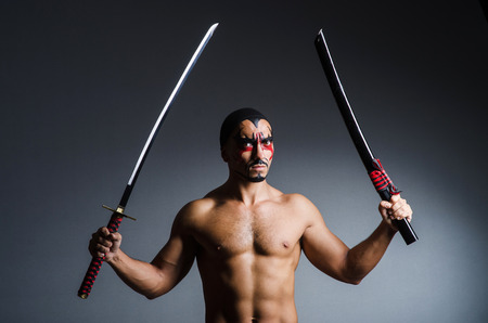 Man with sword and face paint Stock Photo - 22581916