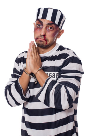 bruised: Badly bruised prisoner with handcuffs