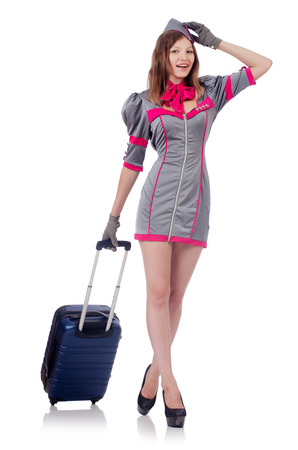 Woman travel attendant with suitcase on white Stock Photo - 22582066