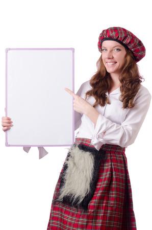 highlander: Mujer escocesa con la tarjeta en blanco Foto de archivo