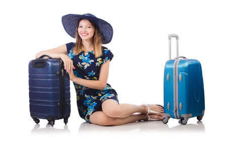 Woman with suitcases isolated on white Stock Photo - 22939889
