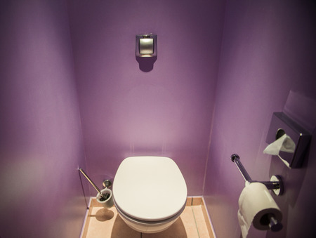 Toilet seat in modern room photo