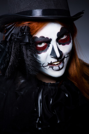 Woman satana in halloween concept photo