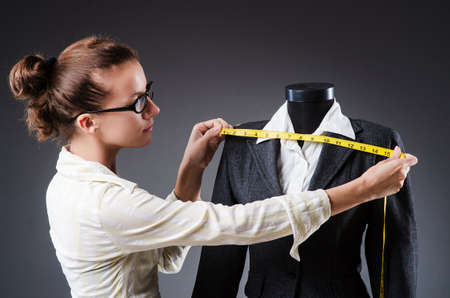 Woman tailor working on clothing Stock Photo