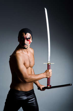 Man with sword and face paint Stock Photo - 23082470