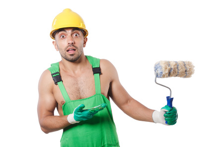 Painter in green coveralls on white photo