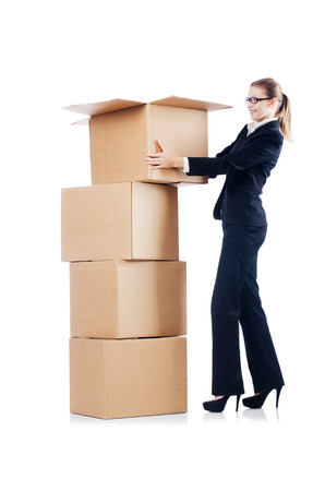 Businesswoman with boxes isolated on white photo