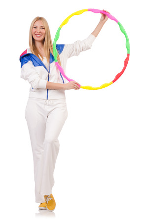 Young woman with hula hoop on white photo