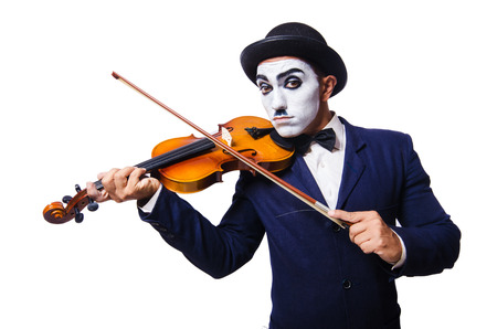 Man with face mask playing violin photo