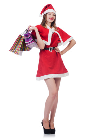 Young woman in red santa costume on white photo