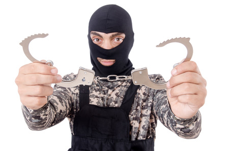 Soldier with handcuffs isolated on white Stock Photo - 22867635