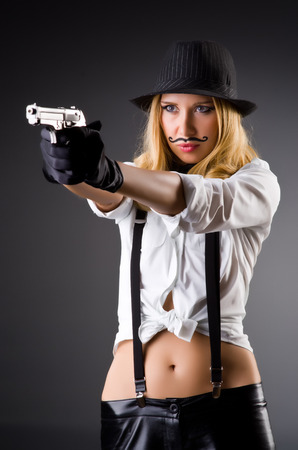 Funny woman with gun and mustache
