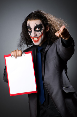 Funny Joker with paper binder photo