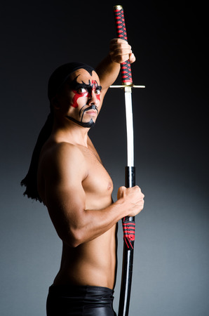 Man with sword and face paint Stock Photo - 23254495