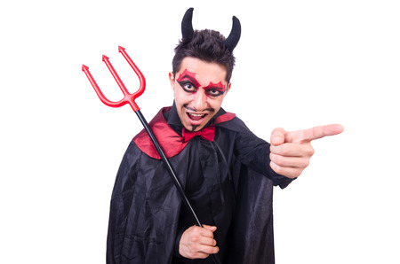 Man in devil costume in halloween concept photo
