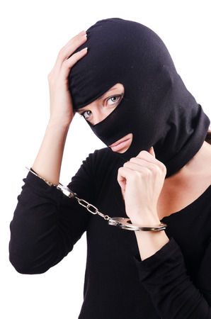 Young female criminal with handcuffs photo