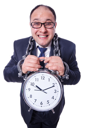 Businessman with clock isolated on white photo