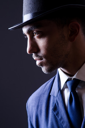Businessman in old style hat photo
