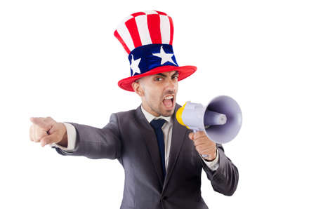 Man with loudspeaker and american hat photo