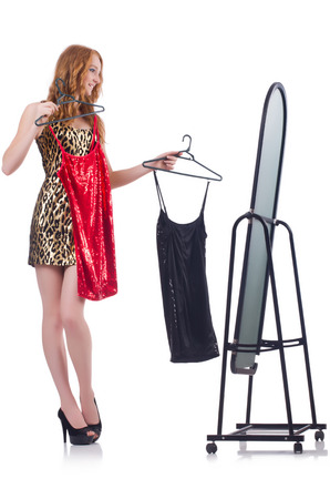 Woman with mirror trying new clothing photo