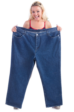 Woman in dieting concept with big jeans Stock Photo - 27276797