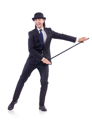 Man dancing with walking stick on white photo