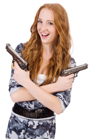 Young woman soldier with gun on white photo