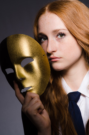 Woman with mask in hypocrisy concept Stock Photo - 23877087
