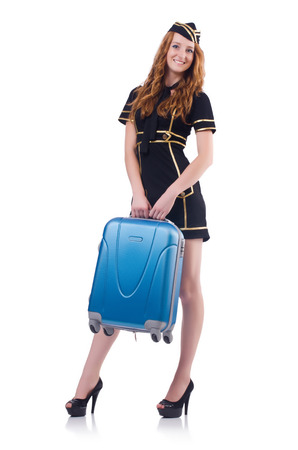 Woman travel attendant with suitcase on white Stock Photo - 23509396