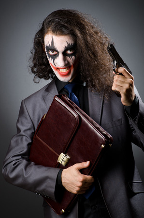 Joker with gun and briefcase photo