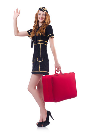 Woman travel attendant with suitcase on white Stock Photo - 23509990