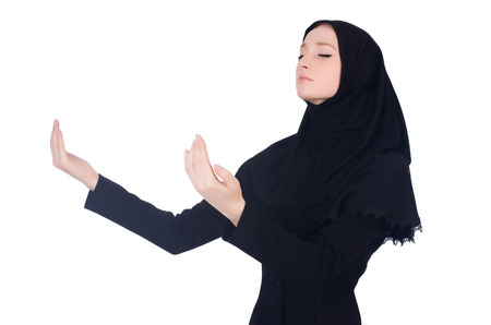 Young muslim woman praying isolated on white photo