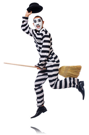 chaplin: Prisoner with broom isolated on the white