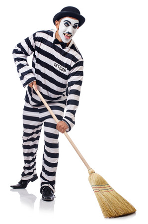 Prisoner with broom isolated on the white Stock Photo - 23510280