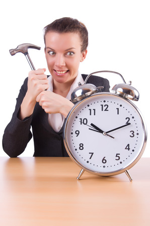 Woman trying to break the clock Stock Photo - 23510517