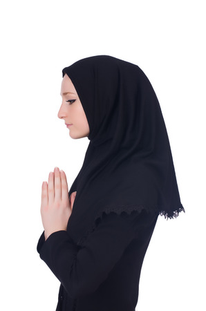 Young muslim woman praying isolated on white Stock Photo - 23514504