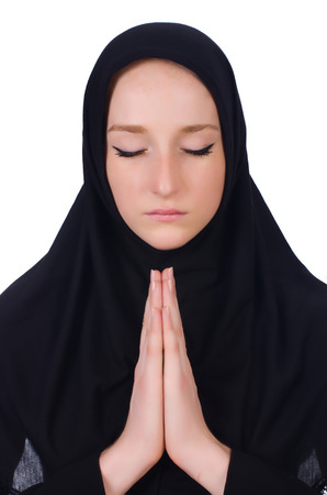 Young muslim woman praying isolated on white Stock Photo - 23551652