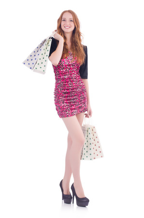 Young woman with shopping bags on white Stock Photo - 23551776
