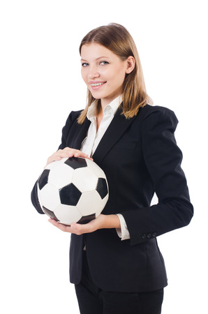 Businesswoman with football on white photo