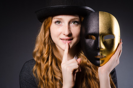 Woman with mask in hypocrisy concept Stock Photo - 23877231